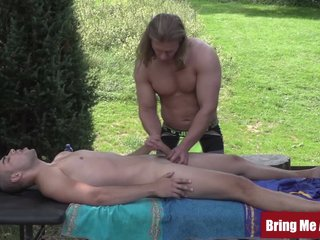 Daddy jerks off twink after massaging his ass outdoors